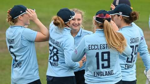 Charlie Dean celebrates a wicket for England