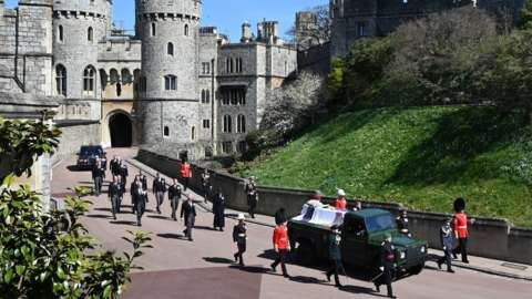 The Land Rover Defender carrying the coffin of the Duke of Edinburgh is followed by members of the Royal Family