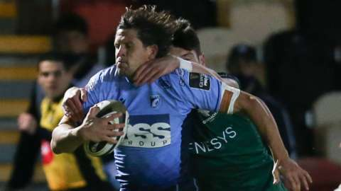 Lloyd Williams of Cardiff Blues is hauled down as he looks to break away