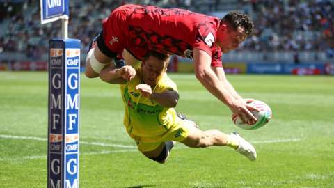 Wales' Joe Goodchild scores against Australia