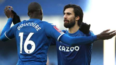 Abdoulaye Doucoure and Andre Gomes celebrate