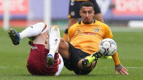 Courtney Baker-Richardson of Newport County and Paudie O'Connor of Bradford City tangle as they compete for the ball