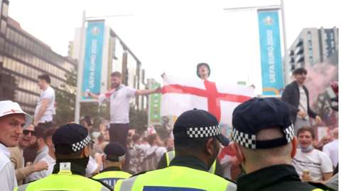 Police and crowds before the Euro 2020 final between England and Italy