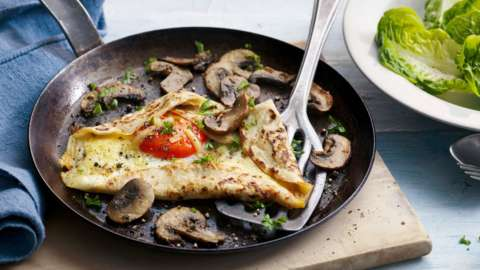 Pancake with mushrooms and fried egg