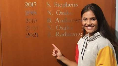 Emma Raducanu with her name on the US Open honours board