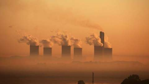 Steam rises from a coal fired power plant in South Africa