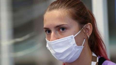 Krystsina Tsimanouskaya escorted at Haneda airport in Tokyo