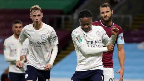 Raheem Sterling celebrates scoring for Manchester City against Burnley in the Carabao Cup