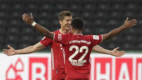 Robert Lewandowski and Serge Gnabry celebrate