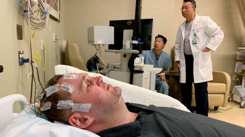 UCLA Health neuroscientists use EEG to observe brain activity in Jason Esterhuizen