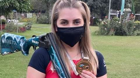 Amber Hill with her skeet World Cup gold medal