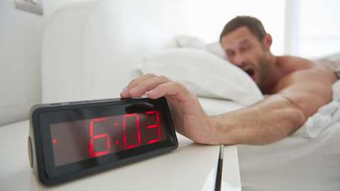 Man hits snooze on his alarm clock