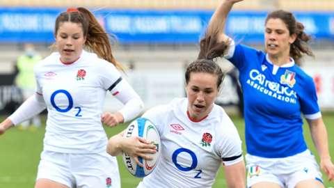 England's Emily Scarratt scores a try