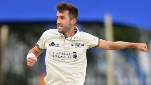 Gloucestershire bowler Matt Taylor celebrates a wicket