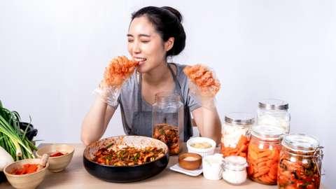Woman eating homemade kimchi
