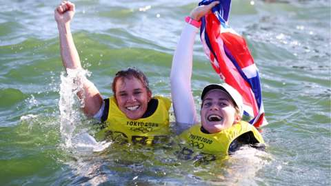 Hannah Mills and Eilidh McIntyre celebrate in the water after jumping in