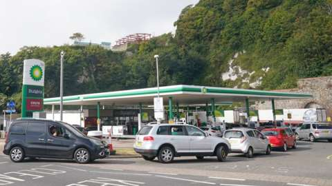 Cars queue at a petrol station in Dover