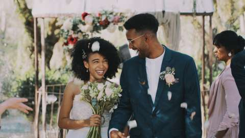 Newlywed couple walking down the isle together after being announced as husband and wife