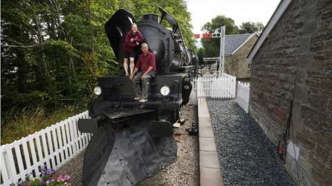 Di and Simon Parums aboard their replica steam