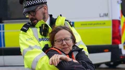 Police officer arrests a protester