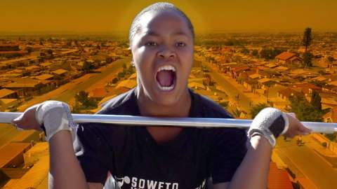 Dimpho Mabuya lifting weights on the background of Soweto