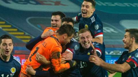 Scotland celebrate David Marshall's winning save