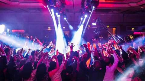 People dancing at an Asian wedding