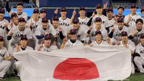 Japan baseball team celebrate winning gold in men's baseball