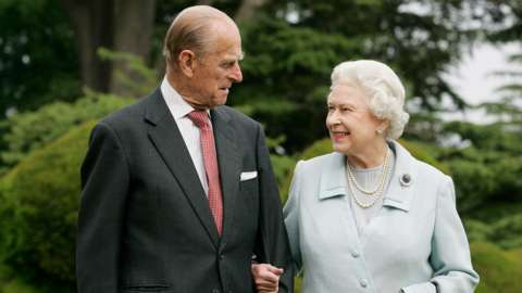 HRH The Duke of Edinburgh and Her Majesty The Queen arm in arm