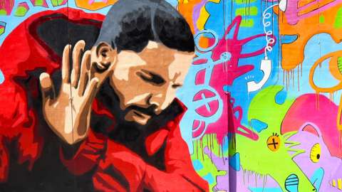 Graffiti mural showing the singer Drake in the Hotline Bling music video, which is often used in memes