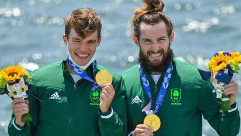 Paul O'Donovan and Fintan McCarthy celebrate winning gold