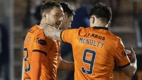 Peter Pawlett (left) celebrates his Dundee United goal