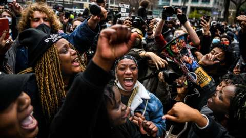 People celebrate as the verdict is announced in the trial of former police officer Derek Chauvin outside the Hennepin County Government Center in Minneapolis, Minnesota on 20 April 2021