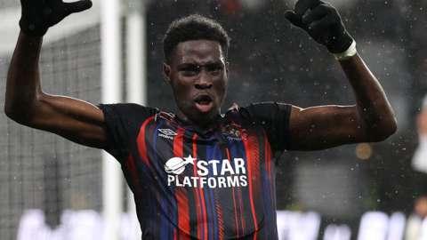 Elijah Adebayo celebrates