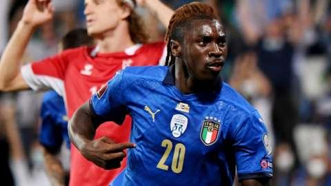 Moise Kean celebrates scoring for Italy against Lithuania
