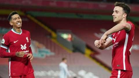 Roberto Firmino and Diogo Jota celebrate