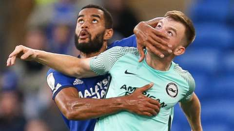 Cardiff City's Curtis Nelson tangles with Brighton's Marc Leonard