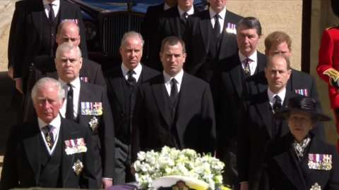 Procession walking behind Prince Philip's coffin