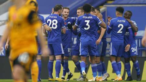 Leicester's players celebrate scoring against Wolves in the Premier League