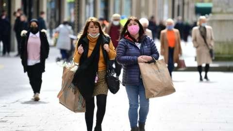 Two women walking down the street