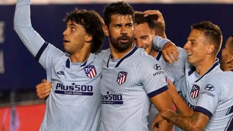 Atletico Madrid players celebrate a goal against Osasuna