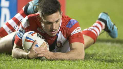 Salford Red Devils full-back Niall Evalds scores a try