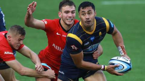 Worcester full-back Melani Nanai is tackled by Ali Crossdale and Charlie Watson of Saracens