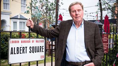 Harry Redknapp next to the Albert Square sign