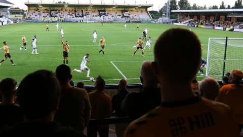 Cambridge United fans watch the game