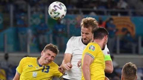 Harry Kane heads the ball against Ukraine