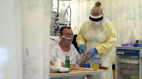 A nurse treats Brian in ICU