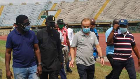 Nigeria coach Gernot Rohr inspects the facilities at the Teslim Balogun stadium with other officials