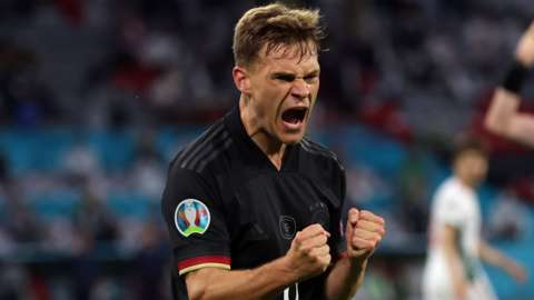 Germanys Joshua Kimmich celebrates after Germany equalise against Hungary at Euro 2020