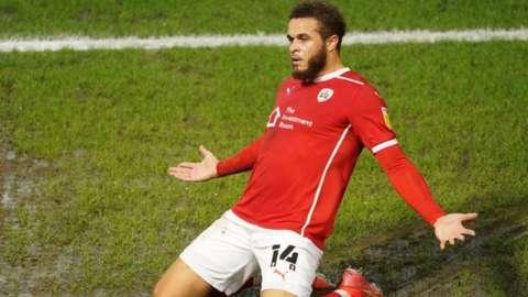 Carlton Morris celebrates scoring Barnsley's first goal
